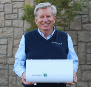 Steve holding a healthy h20 systems product